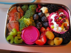 I work at a small Christian school for seed money but in one way or another I bring the farm with me in my bento-lunches everyday. They are made of a couple of ounces of protein from dinner the night before, a serving of carbs and fruits and vegetables in the five colors. Just because I love it, I also like to bring a silicone cupcake of plain yogurt with fruit (or, in this case, with Trader Joe's chocolate coated sunflower seeds. This bento also has thinly sliced steak and cubed baked potatoes. The green comes from raw broccoli and celery, th red is from sliced strawberries and beets, yellow from raspberries, white from cauliflower and blue-black from blueberries and blackberries